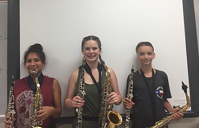 Kids playing sax and oboe